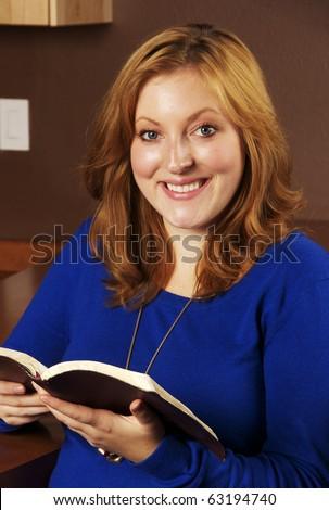 Beautiful Young Woman Reading Her Bible - stock photo