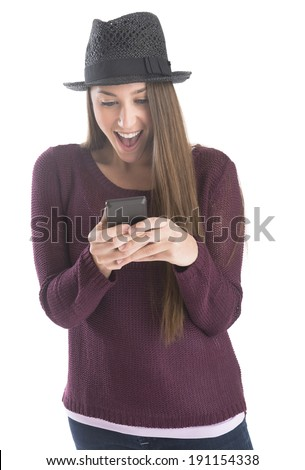 Beautiful young woman reading text message on smart phone over white background - stock photo