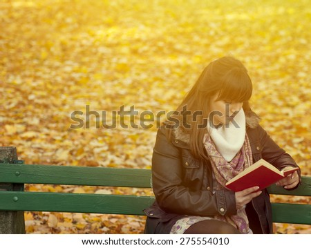 Beautiful young woman reads book