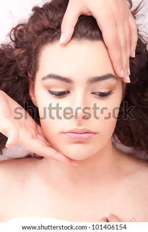 Beautiful young woman receiving a massage - stock photo
