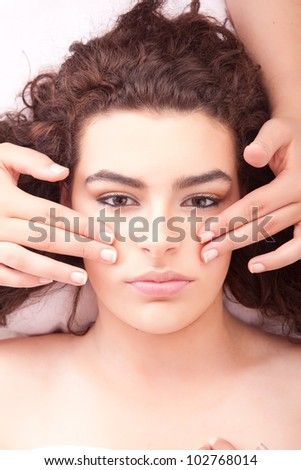 Beautiful young woman receiving a massage