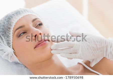 Beautiful young woman recieving injection in hospital