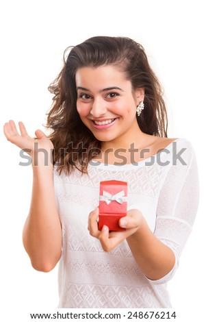 Beautiful young woman recieving wedding ring - stock photo