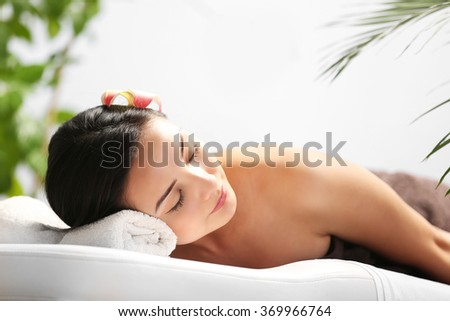 Beautiful young woman relaxing at beauty spa - stock photo
