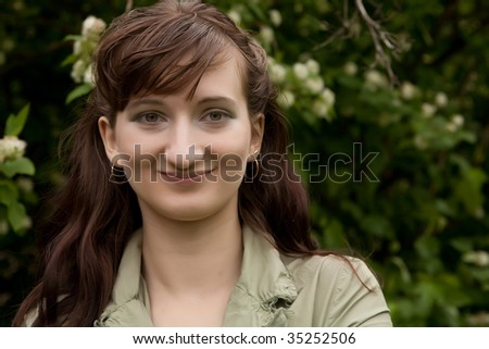 Beautiful young woman relaxing at park