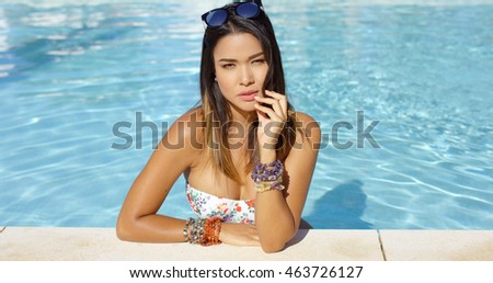 Beautiful young woman relaxing in a swimming pool