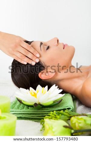 Beautiful Young Woman Relaxing In Spa Saloon - stock photo