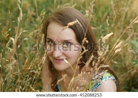 beautiful young woman relaxing in the grass