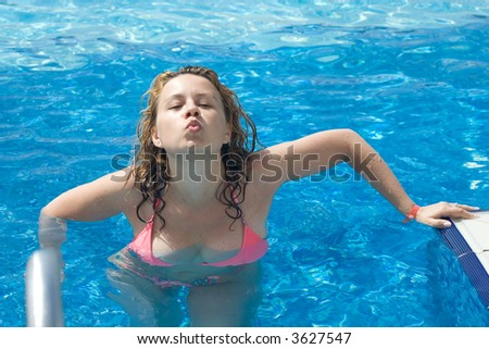 beautiful young woman relaxing in the swimming pool