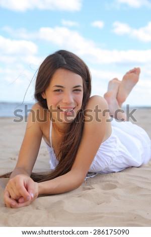 beautiful young woman relaxing on sea - stock photo