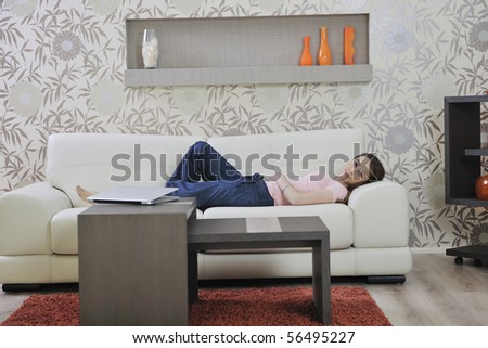 beautiful young woman relaxing on sofa at home