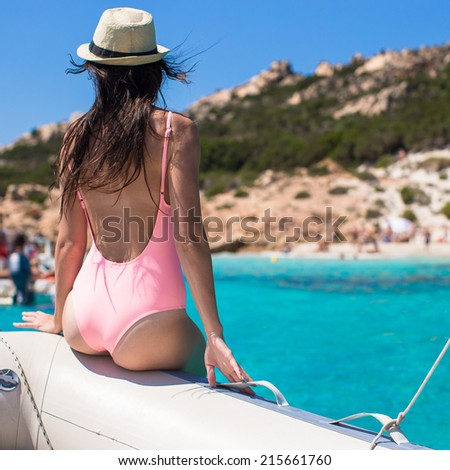 Beautiful young woman relaxing on the boat - stock photo