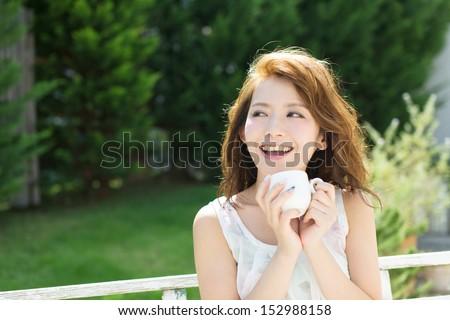 Beautiful young woman relaxing outdoor  - stock photo