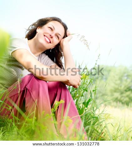 Beautiful Young Woman Relaxing Outdoors. Meadow. Beauty Girl Enjoying Nature - stock photo