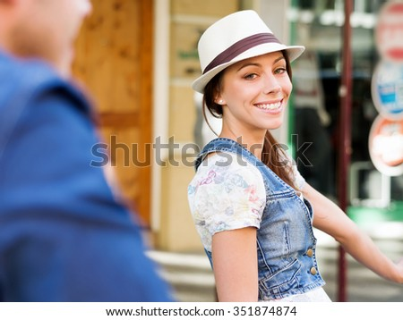 Beautiful young woman riding on bike in city