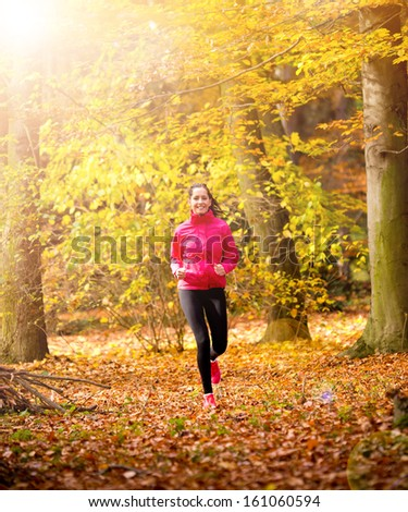 Beautiful Young woman running outdoors - stock photo