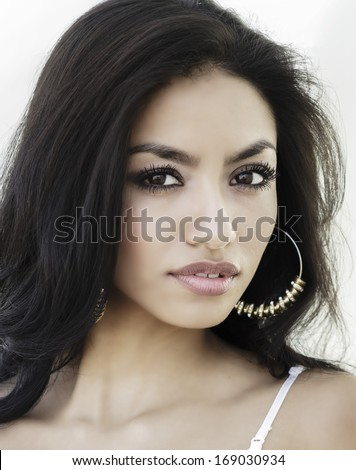 Beautiful young woman's face - stock photo