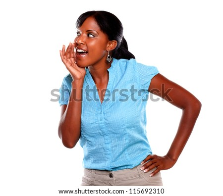 Beautiful young woman screaming on blue shirt against white background - copyspace - stock photo