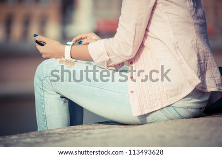 Beautiful Young Woman sending Message with Mobile Phone - stock photo