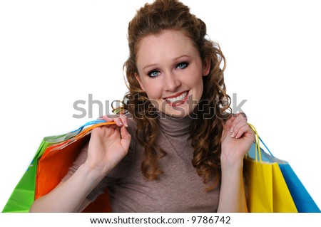 Beautiful young woman shopping and smiling isolated over a white background