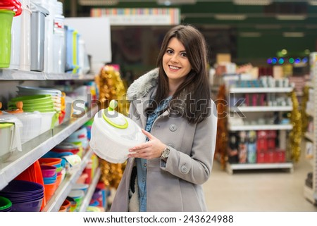 Beautiful Young Woman Shopping For Bowl In Produce Department Of A Grocery Store - Supermarket - Shallow Deep Of Field