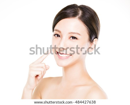 beautiful young woman showing her teeth