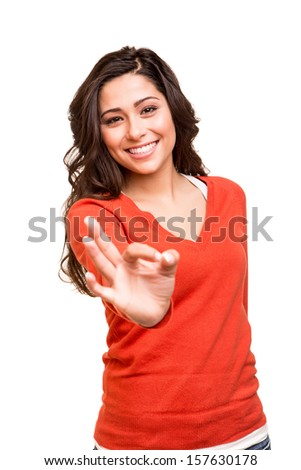 Beautiful young woman showing Ok sign - stock photo
