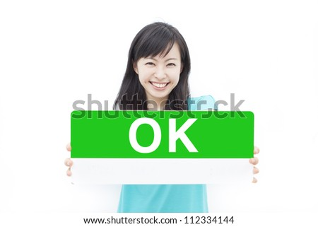 "beautiful young woman showing ""OK"" sign, isolated on white background - stock photo"