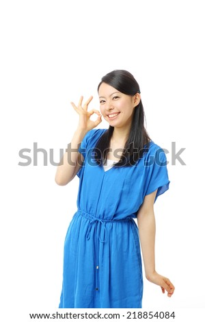 beautiful young woman showing OK sign, isolated on white background - stock photo