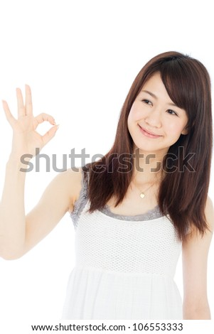 Beautiful young woman showing ok sign. Portrait of asian.