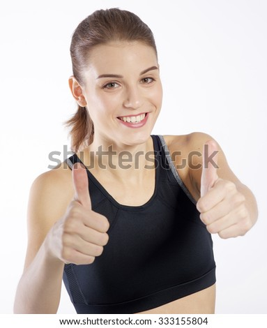 Beautiful young woman showing thumbs up - stock photo