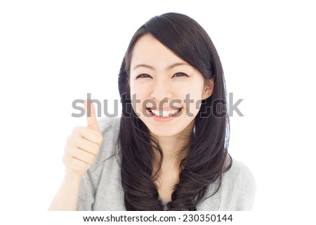 beautiful young woman showing thumbs up gesture, isolated on white background - stock photo