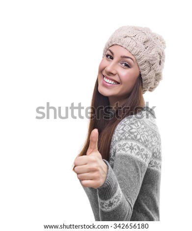 Beautiful young woman showing thumbs up. Isolated on white background.  - stock photo