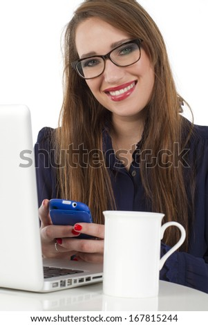 Beautiful young woman sitting in front of her laptop with a smile