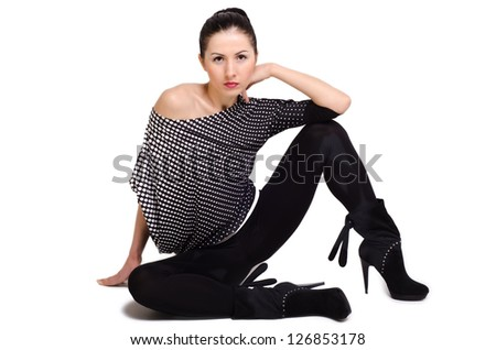 Beautiful young woman sitting on the floor, isolated - stock photo