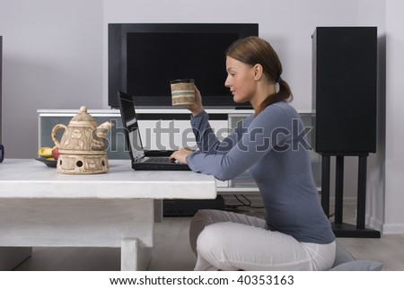 Beautiful young woman sitting  with a cup of coffee