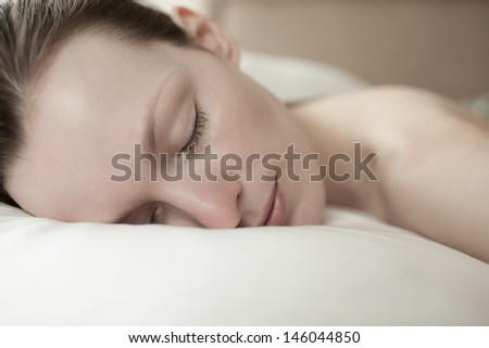 Beautiful young woman sleeping - stock photo