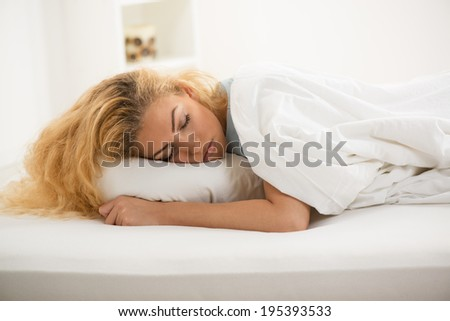 Beautiful young woman sleeping in bed.