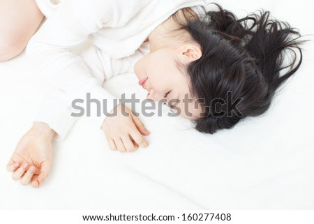 beautiful young woman sleeping on the bed  - stock photo