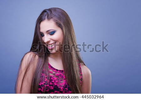 Beautiful young woman, smiling and looking down.