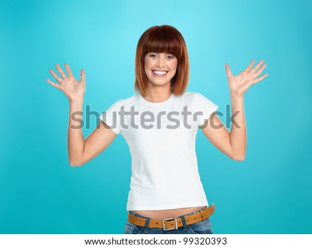 beautiful, young woman, smiling and waving her hands, on blue background