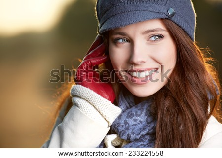 beautiful young woman smiling on a winter's day