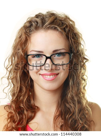 Beautiful young woman smiling with her new pair of eyeglasses isolated on white background