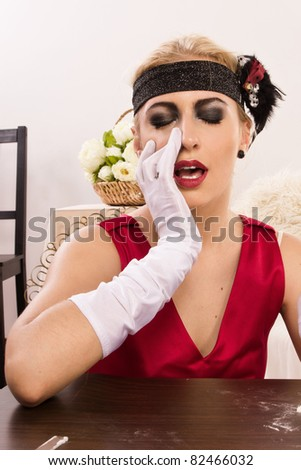 Beautiful young woman sniffing cocaine (Imitation) - stock photo