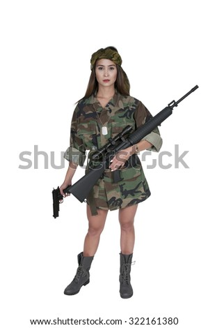 Beautiful young woman soldier with a pistol and rifle