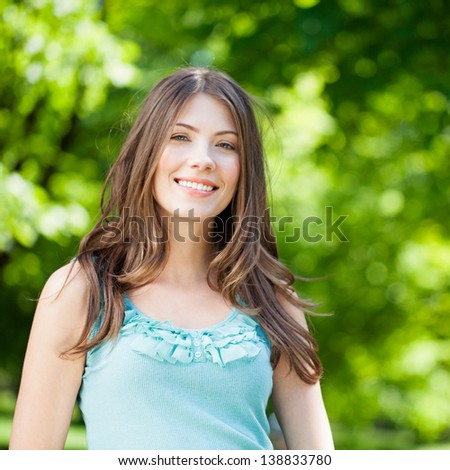 Beautiful young woman spending  day in park.