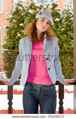 Beautiful young woman stand on a veranda