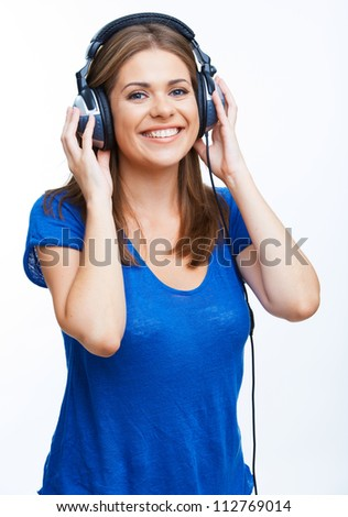 Beautiful young woman standing against white background, isolated. Girl listening Music. - stock photo