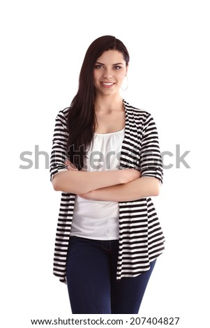 Beautiful young woman standing isolated against white backgrou
