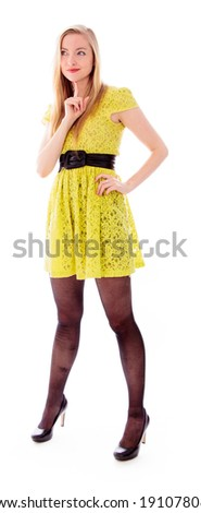 Beautiful young woman standing with her hand on hip - stock photo